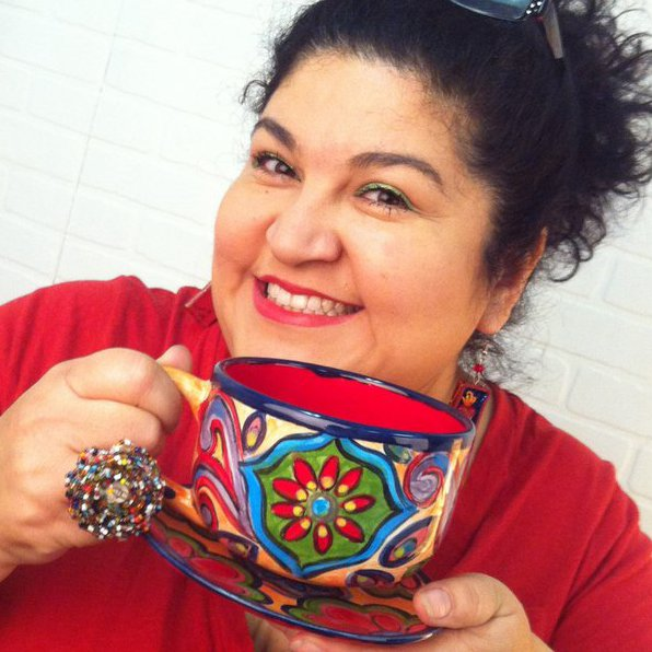 Kathy and one of her beautiful handpainted ceramic mugs!