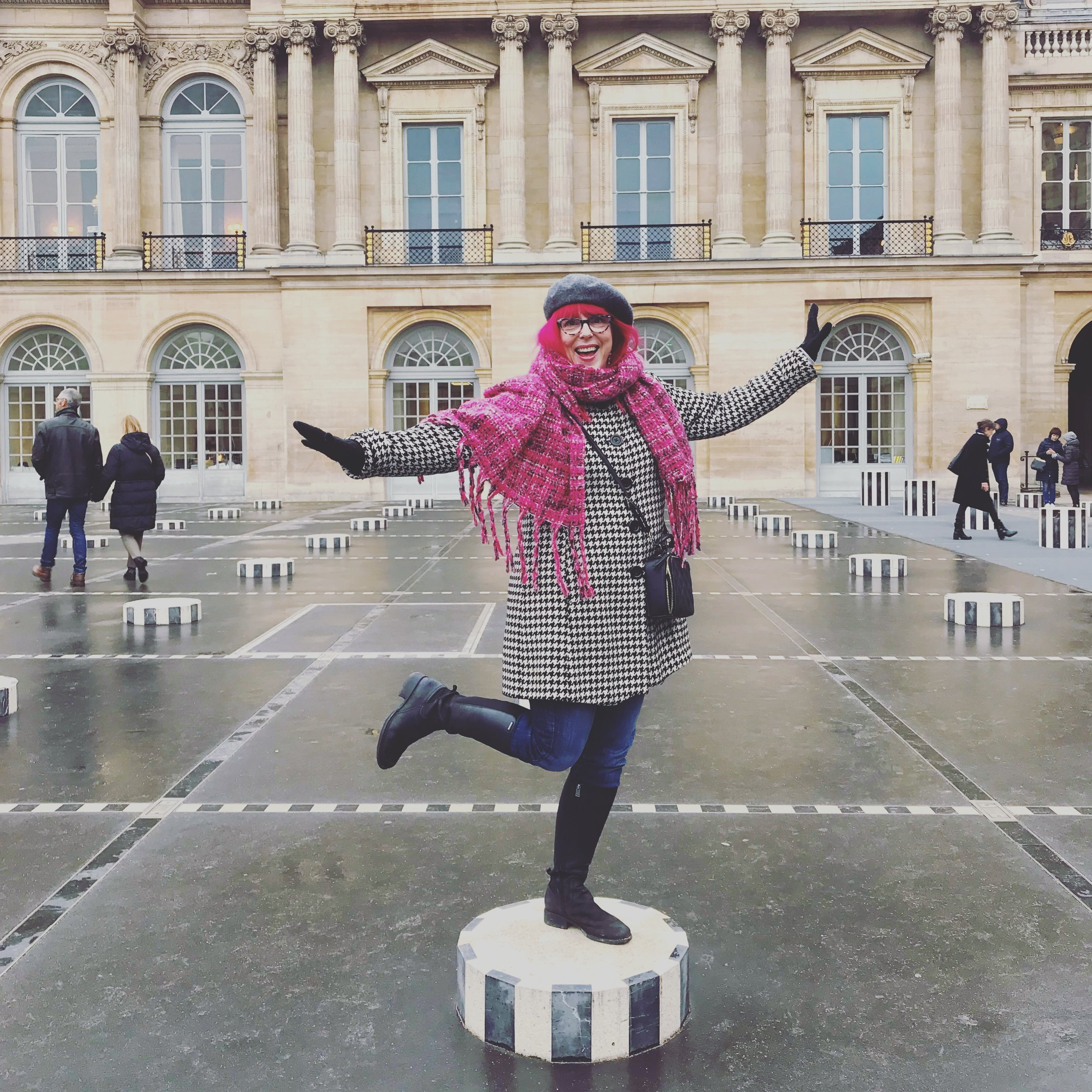 Palais-Royale, in the rain, doing my best impression of a statue.
