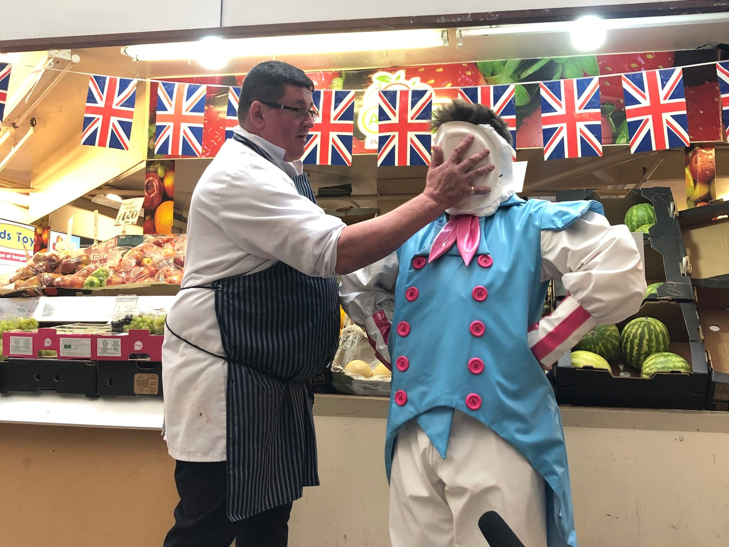 …. and another pie in the face outslde Woresman's Greengrocers, courtesy of Mick from Grosvenors butchers.