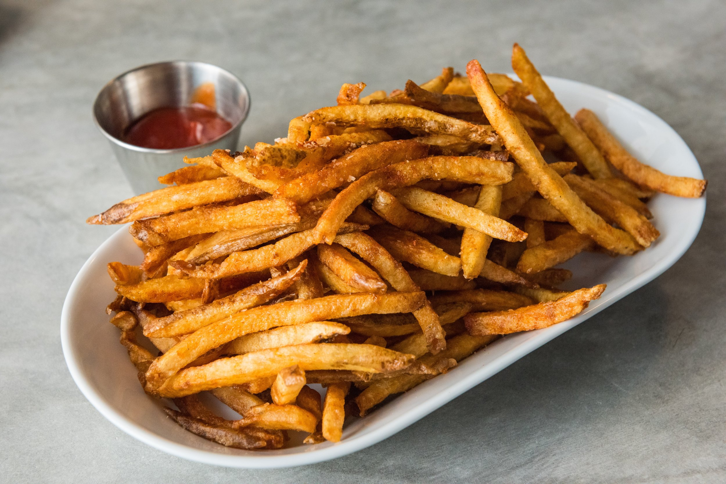 order a side of seasoned french fries to share at Thirsty Mermaid