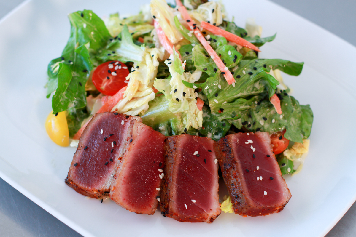 Seared Yellowfin Tuna Salad served on a bed of baby greens at Thirsty Mermaid