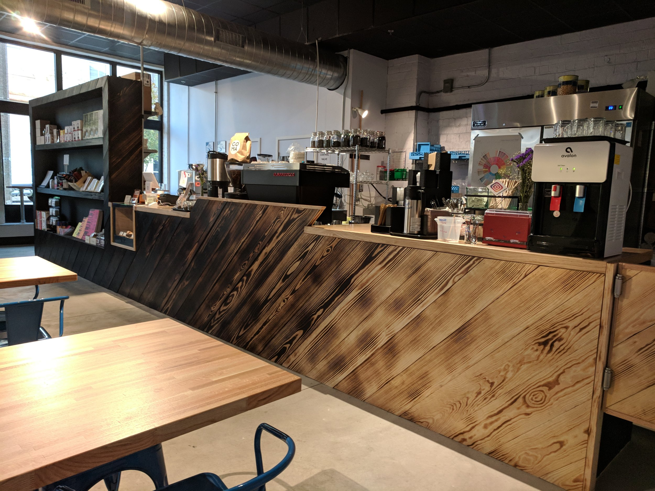Store build-out for local business St. Louis Art Supply. We fabricated custom oak counter-tops, cabinets and shelving clad in a burnt wood gradient treatment, a pastry case, saloon doors, and office space.