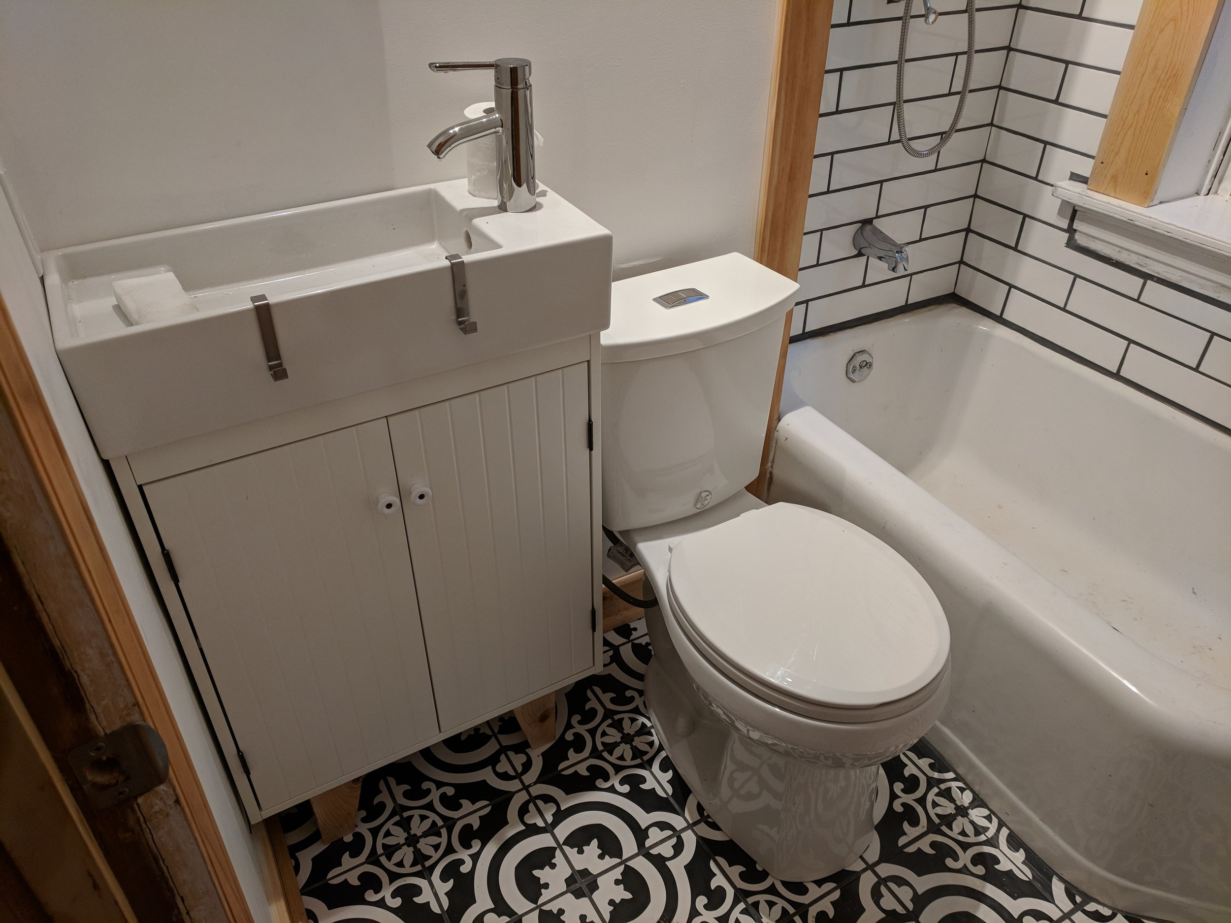 We completely remodeled this bathroom after it was destroyed in a fire in this South City home.  We did the drywall, tile flooring, tile shower surround, framed an exterior wall with custom shelving, and custom medicine cabinet.
