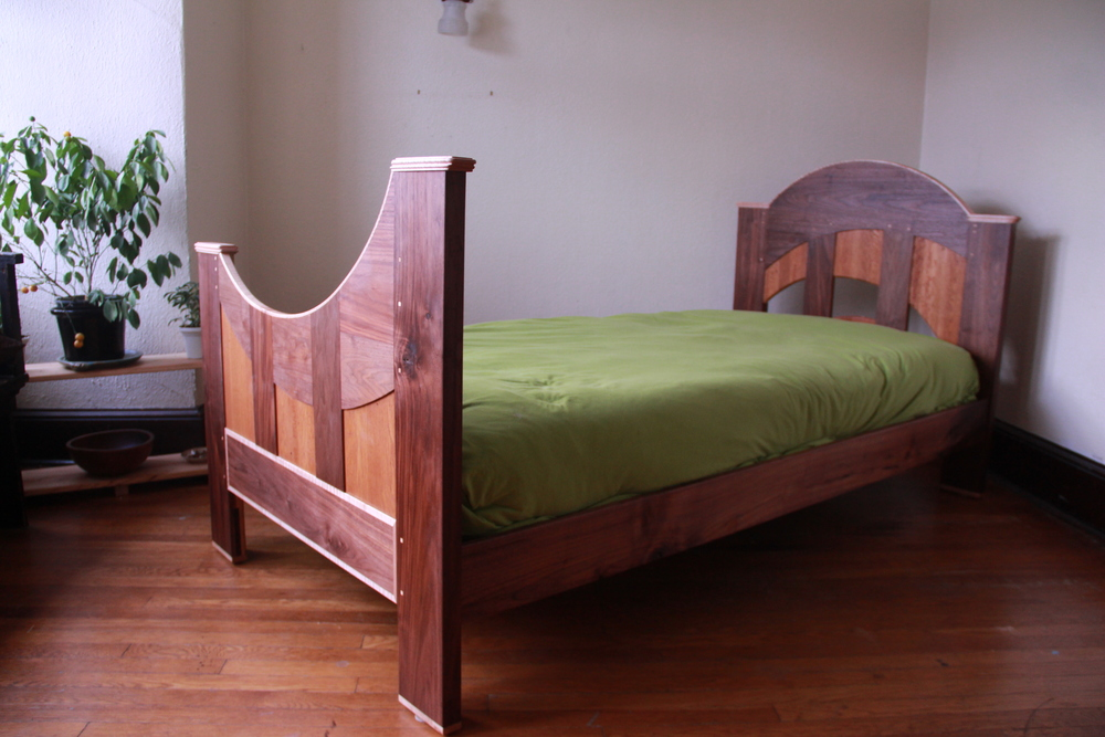 Twin bed frame made from walnut, reclaimed white oak flooring, and maple.