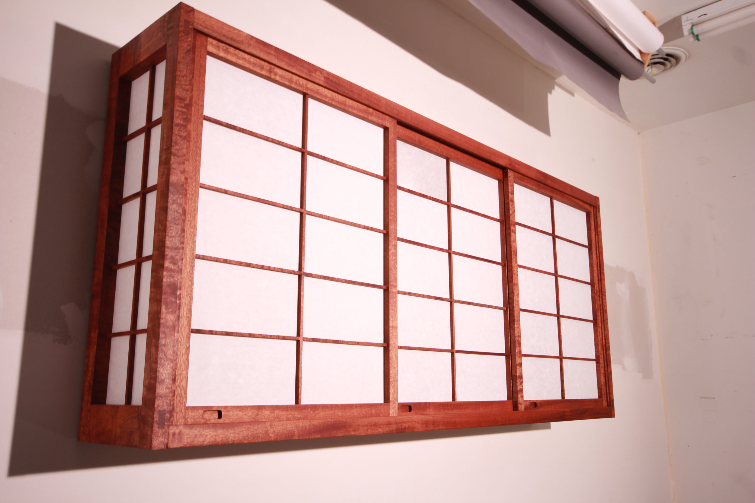 Shoji cabinets made from sapele wood and rice paper.