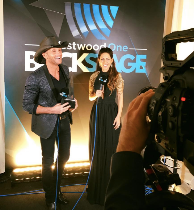 American Music Awards  host  Kerri Kasem  is looking incredibly beautiful in a dress from our Indonesian designer  Lotuz Jakarta , a magnificient shoulder piece by our French designer  Amalia Mattaör  and earrings by our American designer  Sambac Jewelry  while Interviewing Country Music Superstar  Tim McGraw . Styled By  #TeamBitton   Leisa Balfour .  Fashion Provided by  #IvanBittonStyleHouse
