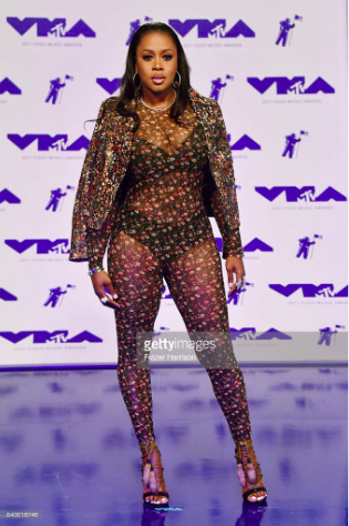 """All the way up"" with rapper  @remyma  taking over the  @mtv music awards  @vmas  red carpet wearing our designers ✨  @sambacjewelry  @jewelsbyhenrydaniel  styled by stylist to the stars  @ejking21  fashion provided by  #ivanbittonstylehouse  #ootd  #celebrity  #singer  #fashiondesigner  #vmas  #redcarpet  #remyma"