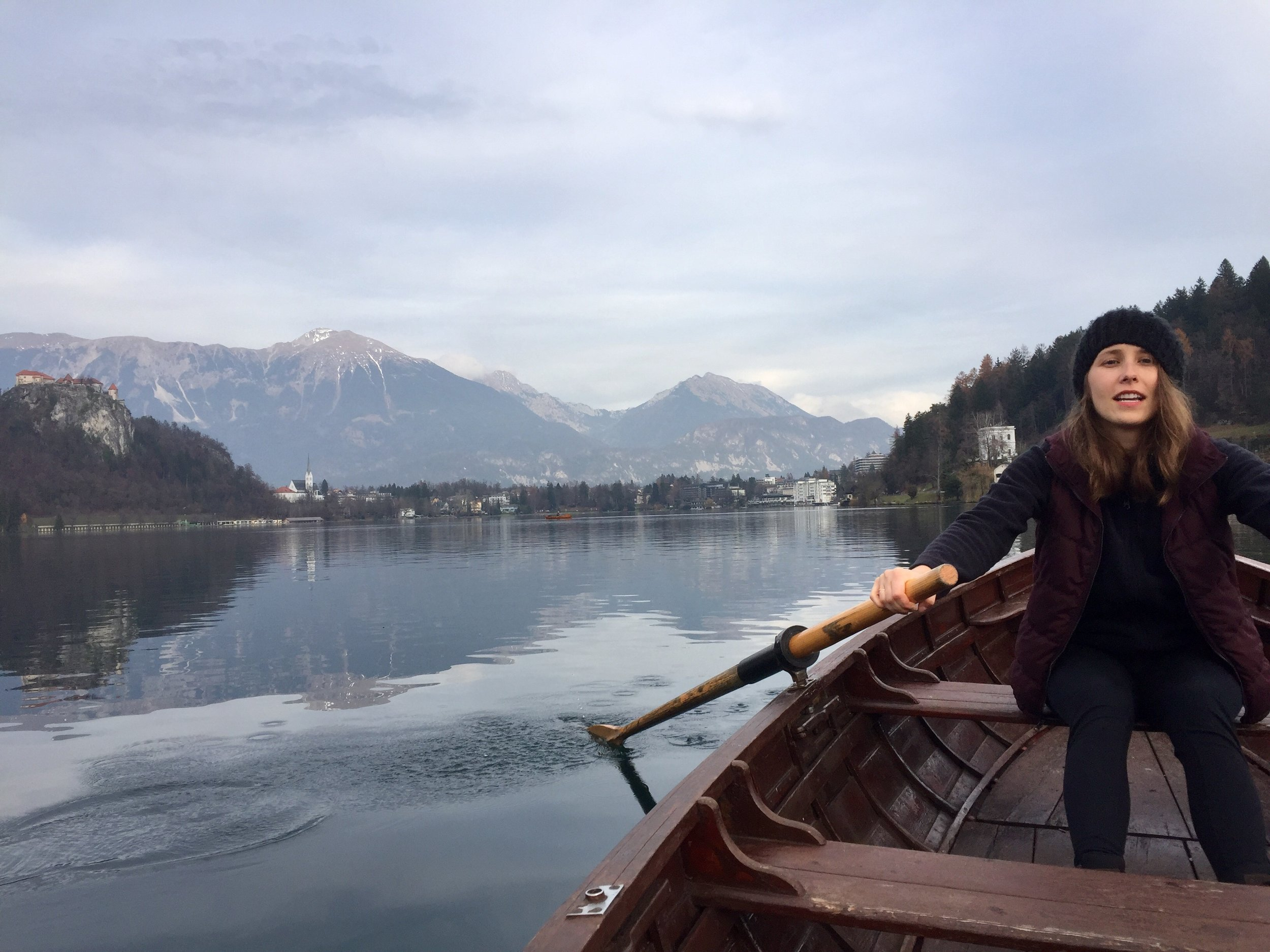 Attempting to row on Lake Bled; views of the Alps in the distance