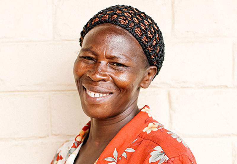 FLAVIA NASSAAZI (HEAD COOK, KATUUSO PRIMARY, UGANDA)   Maama Flavia joined our team in 2010 when School for Life started construction of our first school in Katuuso. She is a highly respected village elder and has been an active voice within the community, helping drive stakeholder engagement and parental participation. Maama Flavia arrives at work at 4am and prepares approximately 300,000 meals every year!
