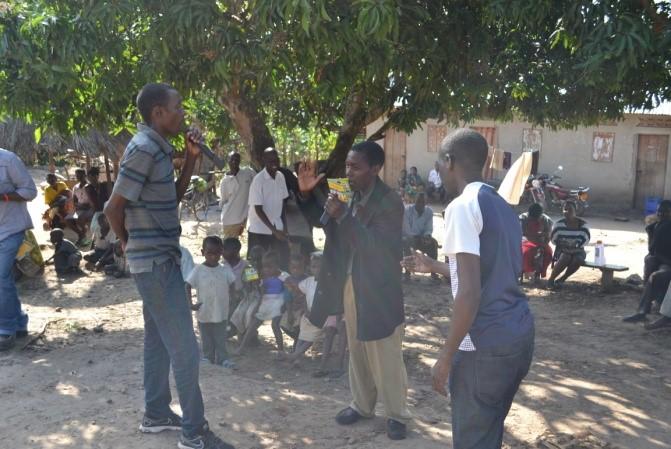 Men from Buzimwa village discuss topics raised during the workshop.