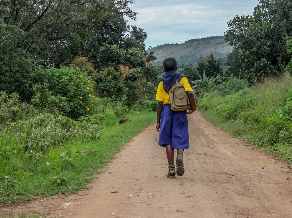 Goretti starts her day early, waking around 5am and walks for over an hour to fetch water before walking to school.