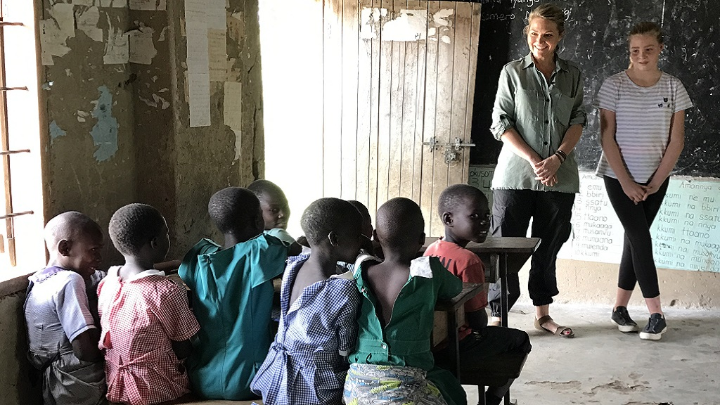 Bronte stays close to her Mum's side at the first government school they visit in Uganda.