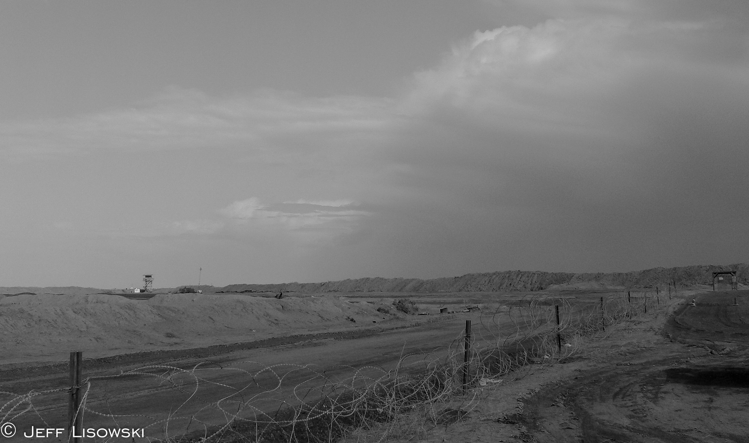 A thunder- and dust- storm rolls across Camp Cedar and Nasiriyah in November of 2009.