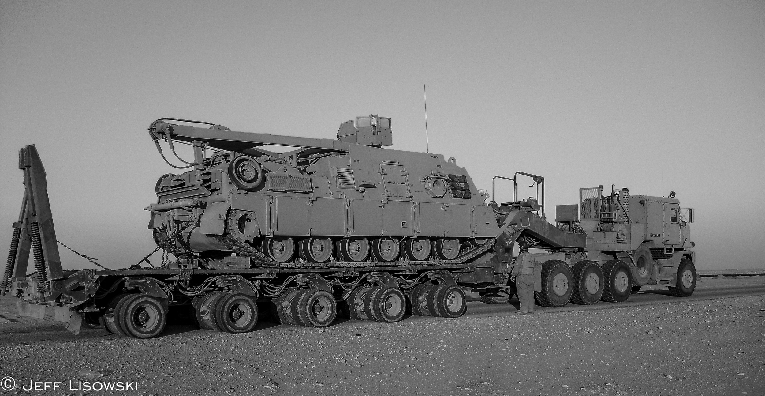 Our HET with an M88 tank recovery vehicle. (140,000 lb. payload)January 2010 in the Al Najaf desert.