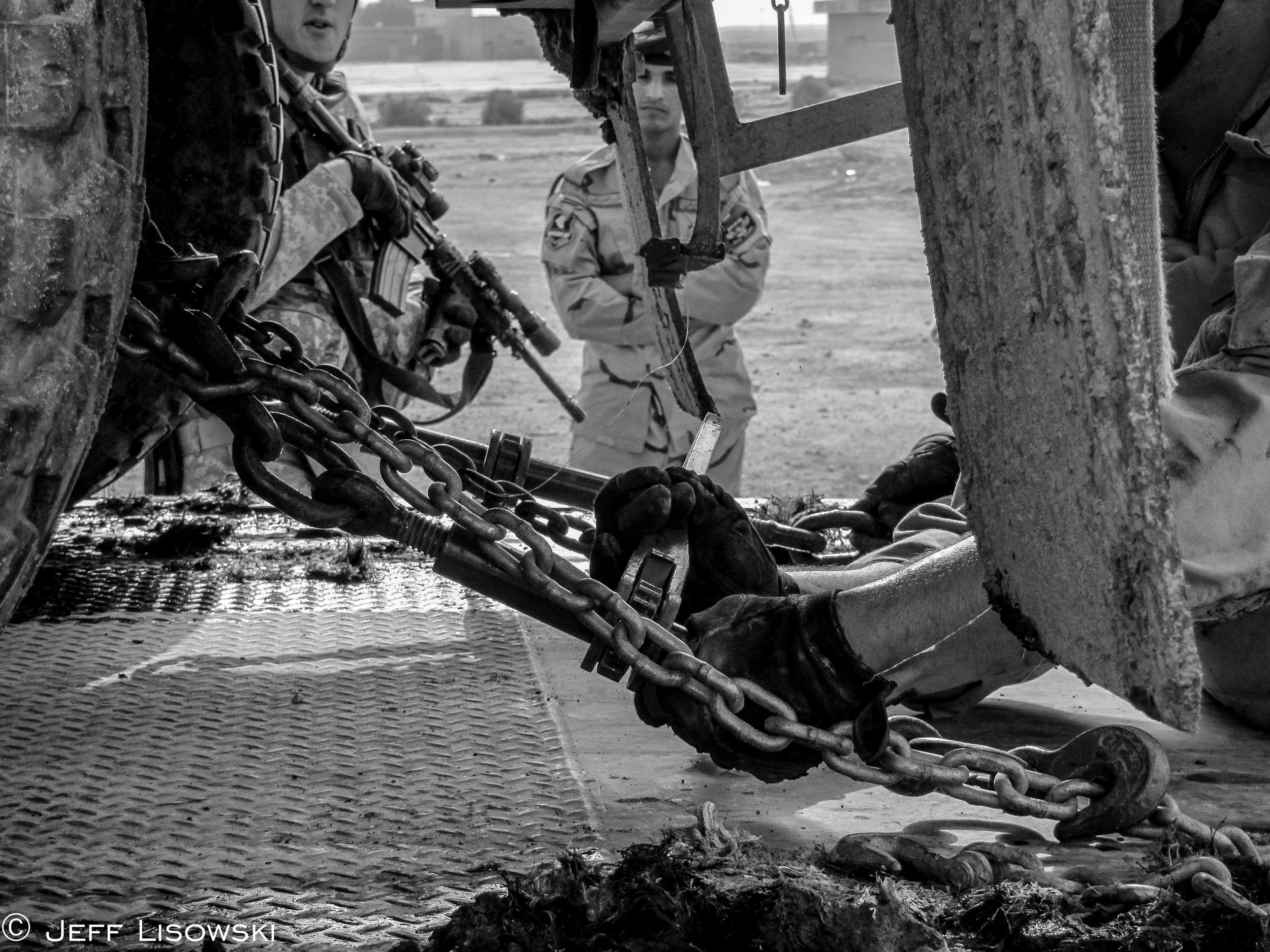 Tying down equipment on the east side of Nasiriyah. Summer of 2010.