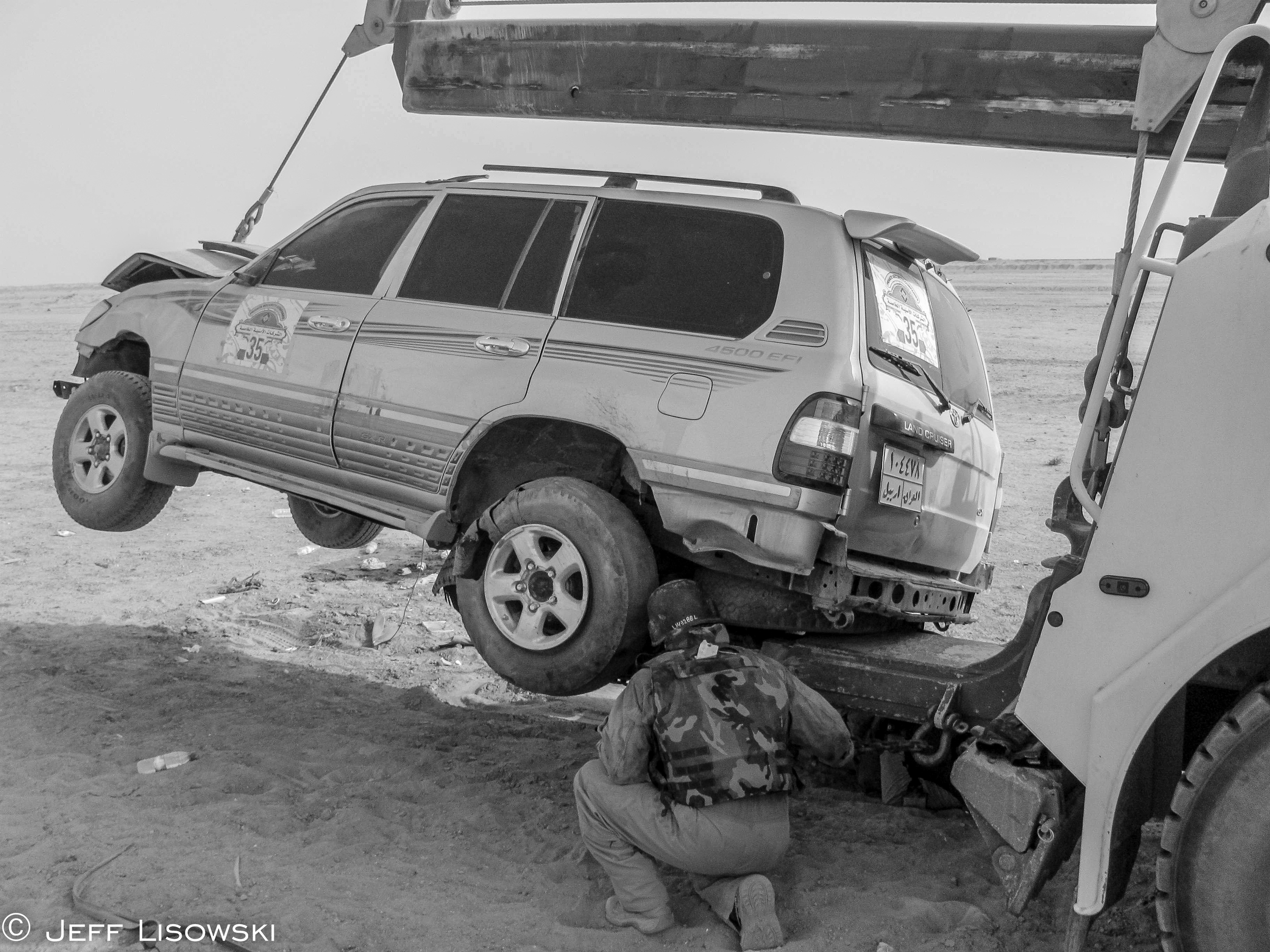 When the HET trailer was full and you got called to pick up more equipment- you improvised. Here a British security company's armored SUV is loaded onto the underreach of our EMPL wrecker. Hey, it worked.