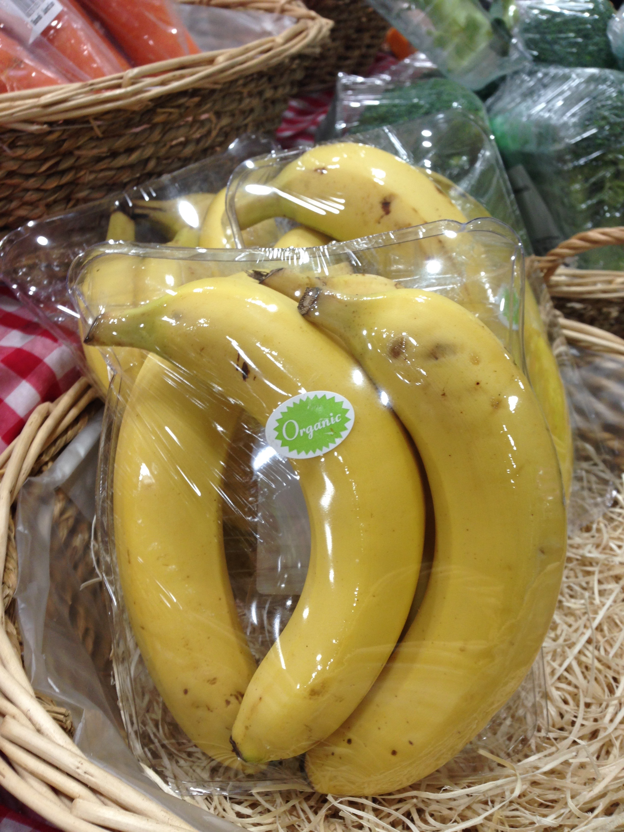 Bananas in plastic at Norton Street Grocer in Bondi Junction.