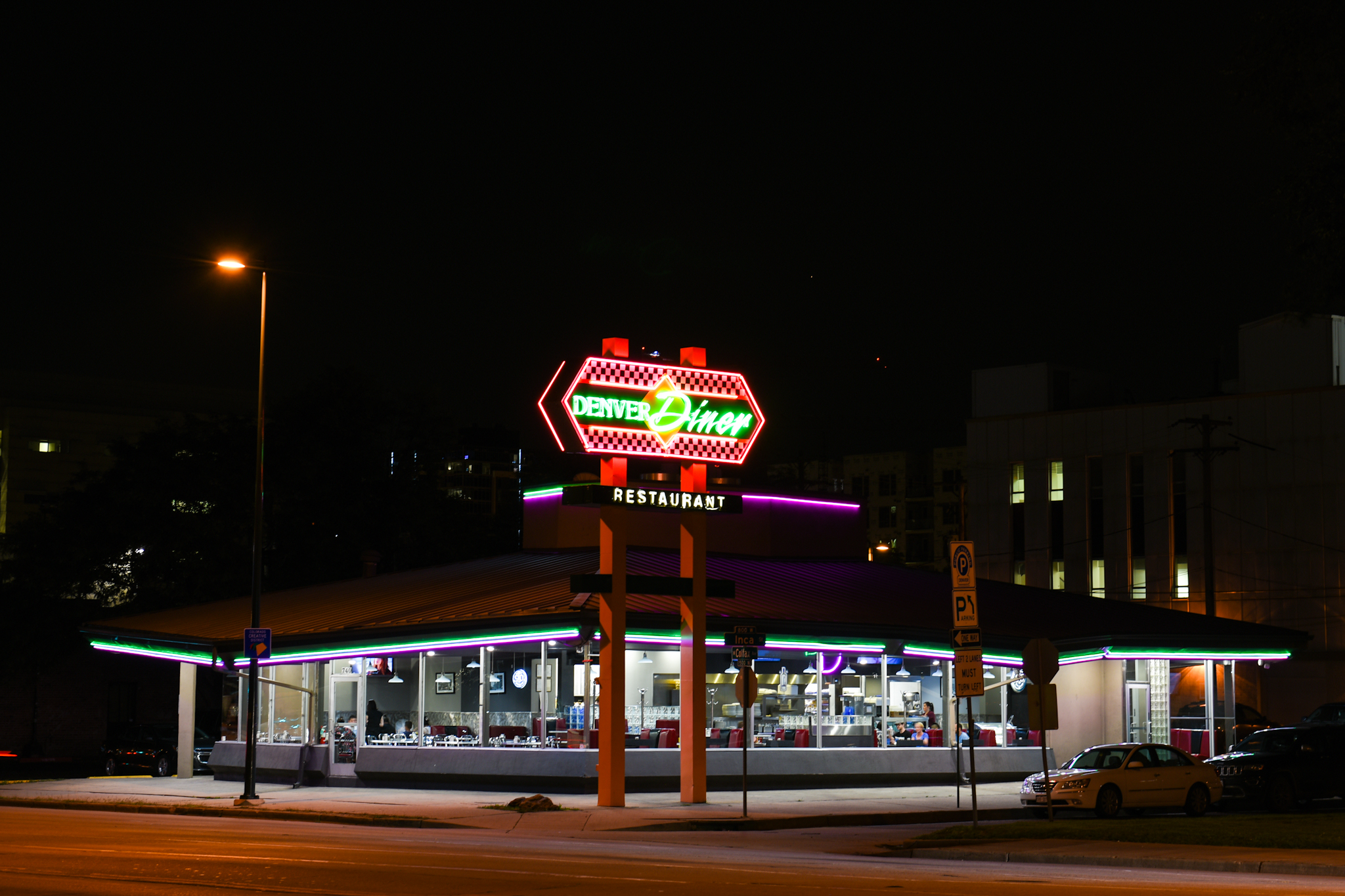 9 p.m.: Purple, green and pink neon lights shine from 740 West Colfax Avenue.