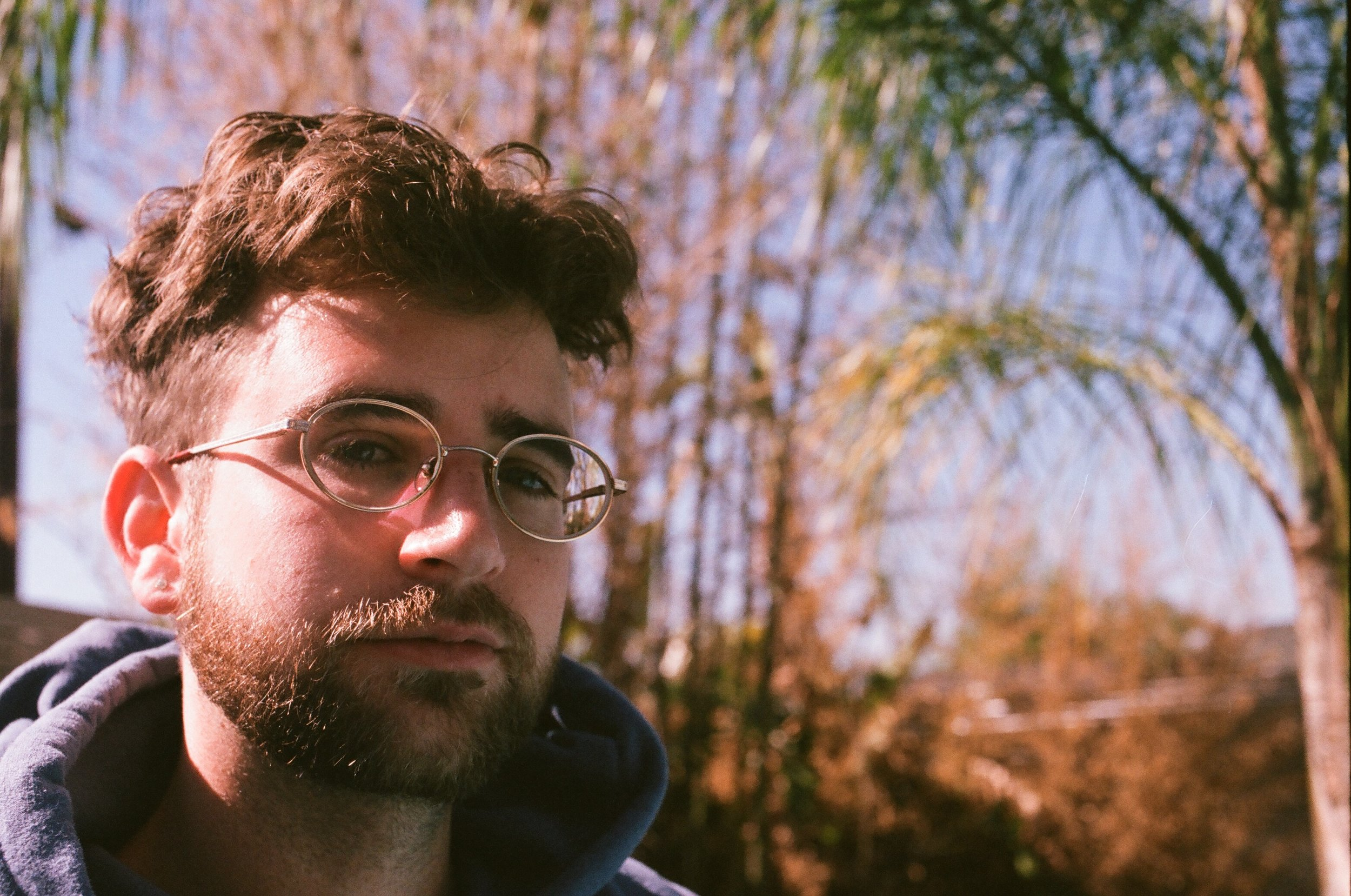 Calvin Valentine in His Backyard on 35mm film by Emily Berkey