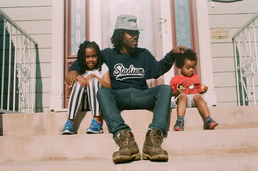 Yanai, Thurz, and Kingston in front of their home in Inglewood, CA