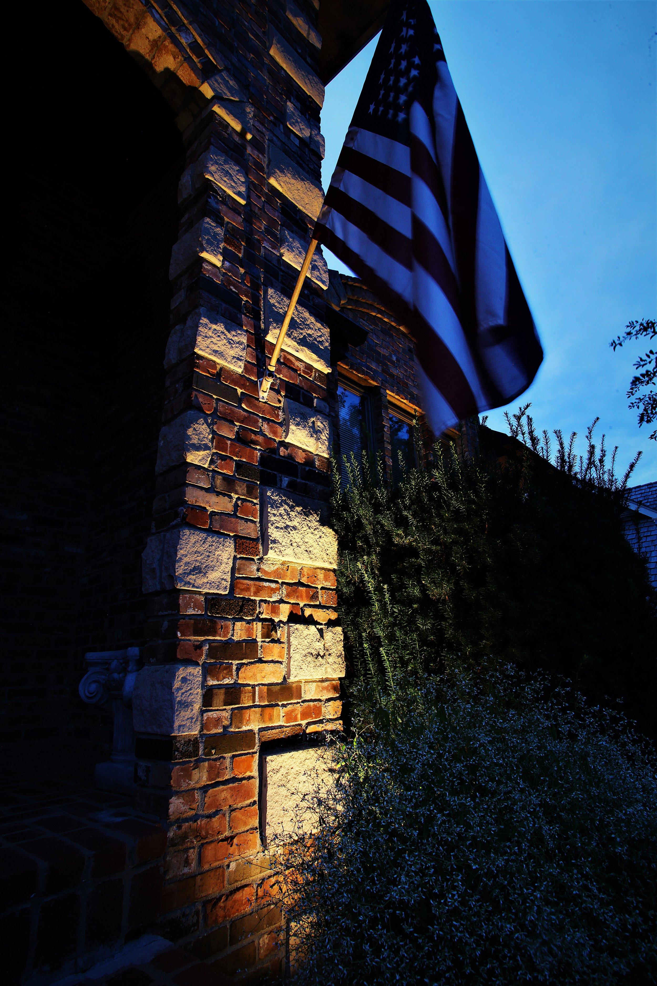 American Flag on Home Outdoor lighting.jpg