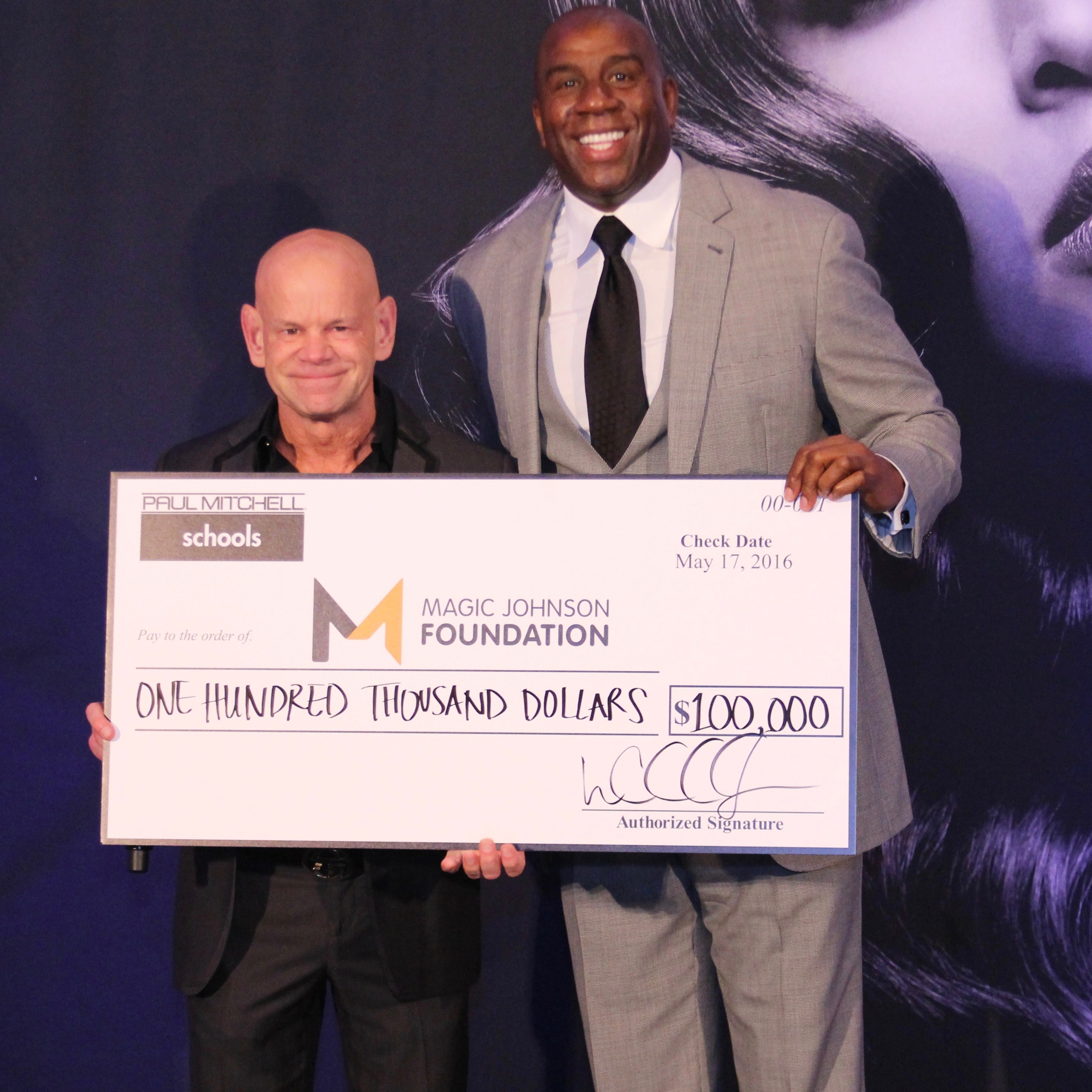 Winn-Magic Johnson big check.jpeg