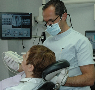 Dr. Halaby and a patient. Source: h ttp://www.dentisterieesthetiquemontreal.com/entry_e.htm