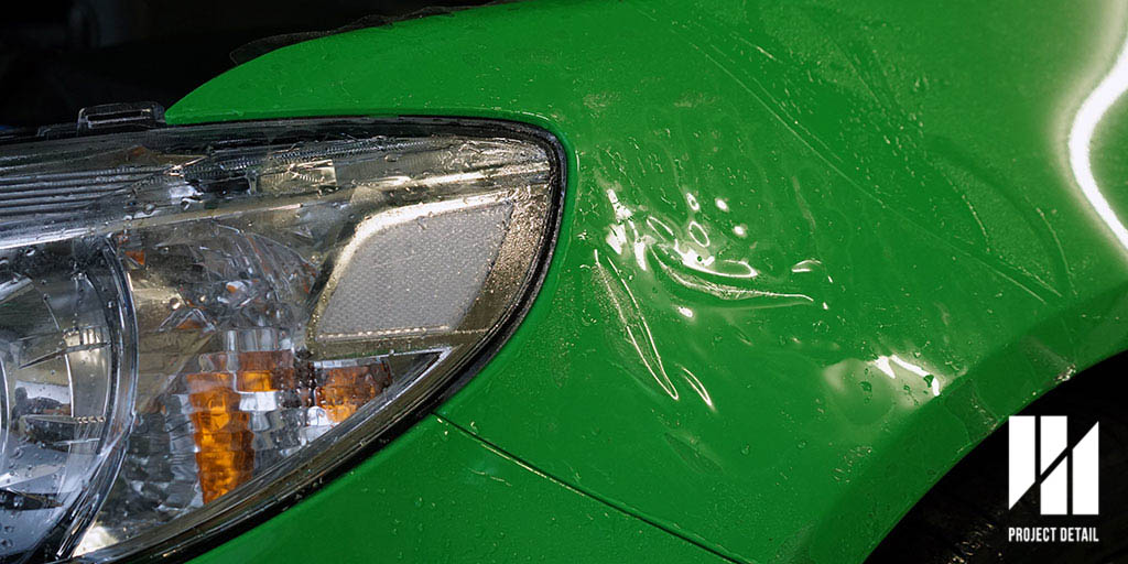 Because of the extreme flare on the Commodore's front guard, covering the front 1/3 is a great way to prevent stone chips without covering the entire panel. The film is wet installed and requires time to dry in order to achieve better clarity and to ensure the edges are properly dry.
