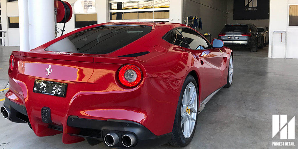 Ferrari F12 Berlinetta ready for pickup, RS6 and R35 GTR in background at Project Detail HQ.