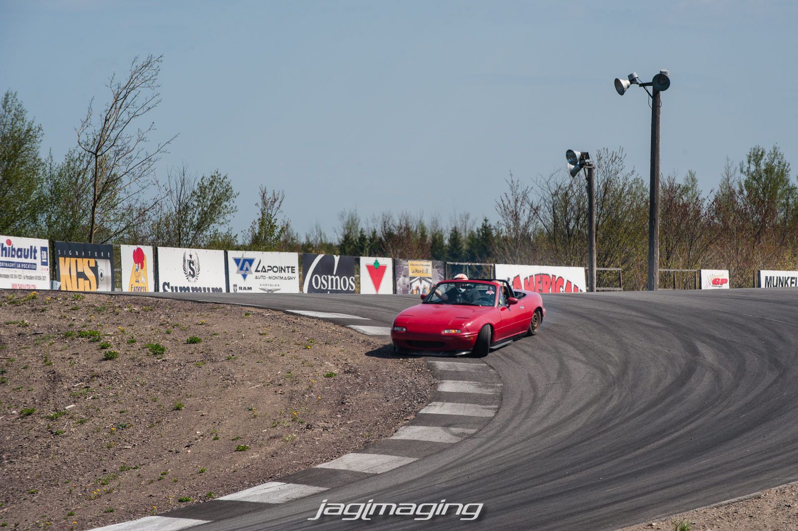 Little Miata about to drop a tire coming down.