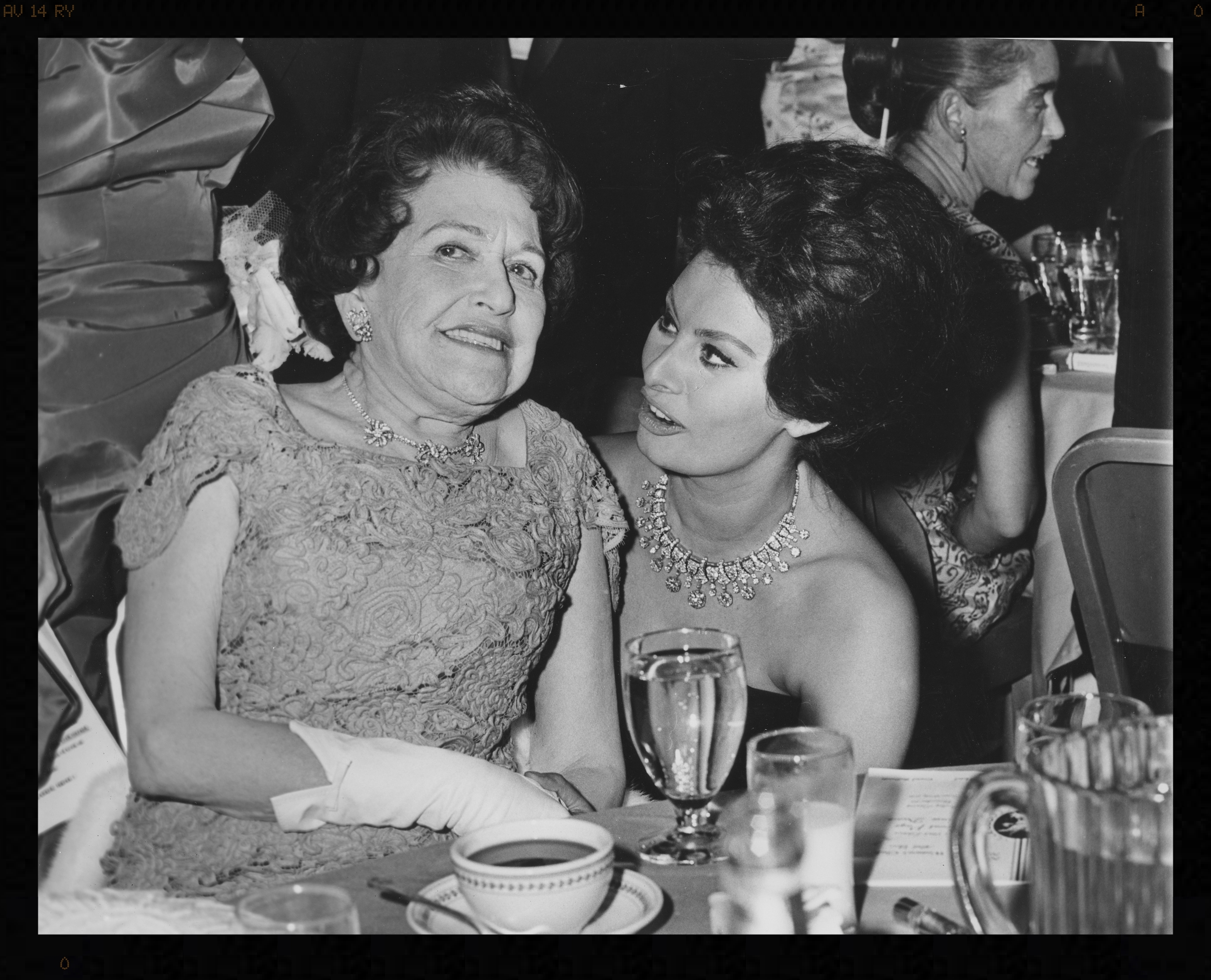 Gossip columnist and radio show host Louella Parsons and actress Sophia Loren at a Newswomen's Club Front Page Ball. Parsons was president of the New York Newspaper Women's Club in 1925.