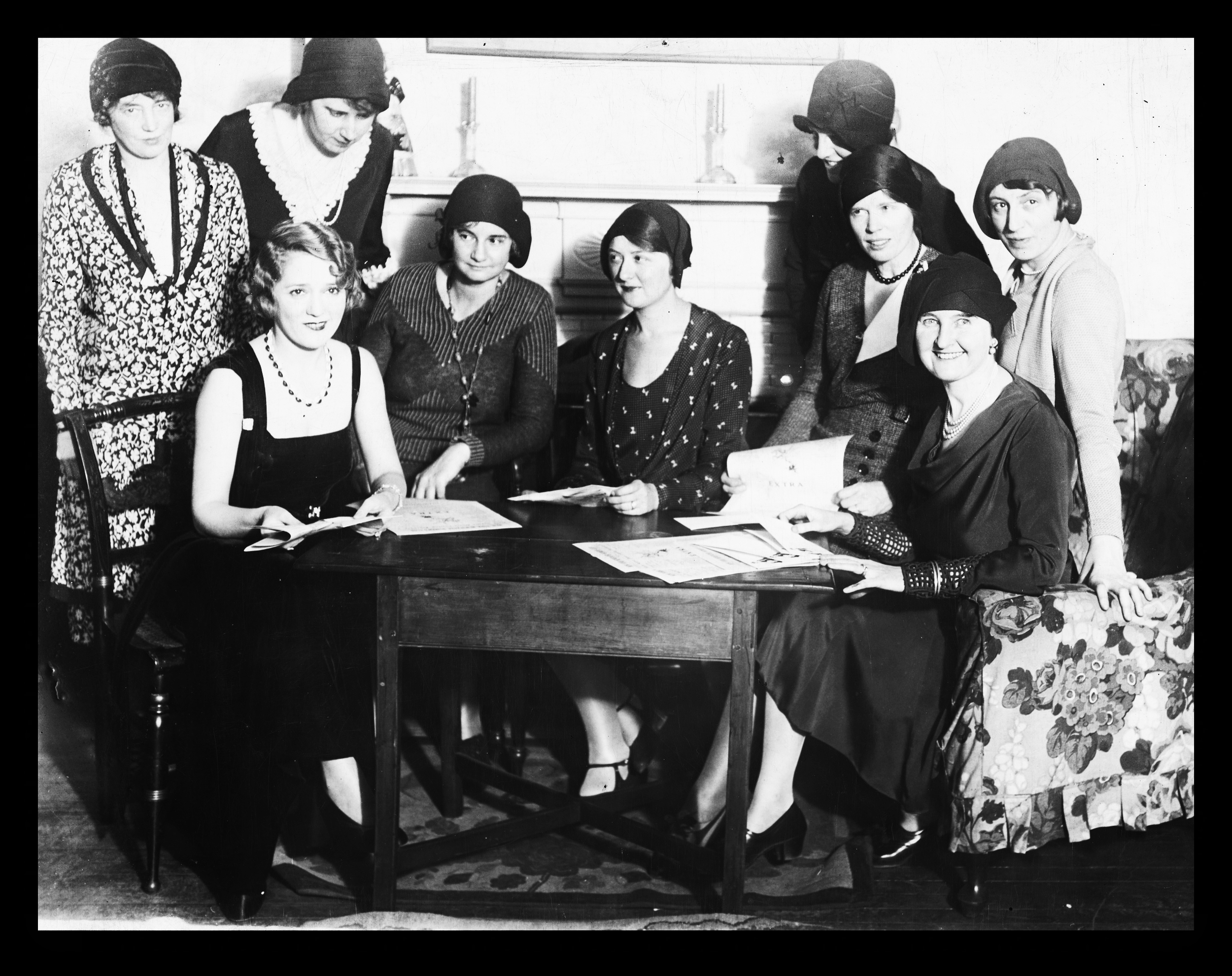Actress Mary Pickford plans the 1931 Front Page dinner with (seated from left): Marian Clyde McCarroll, Evening Post; Charlotte Payne, Chicago News; Anne Lee, Bronx Home News; Ethel Mockler, New York World; and Geraldine Sartain, World-Telegram.  Standing (second from left) are Elsie McCormick, New York World, (left) Deborah Corle and (far right) Emma Bugbee, New York Herald Tribune.