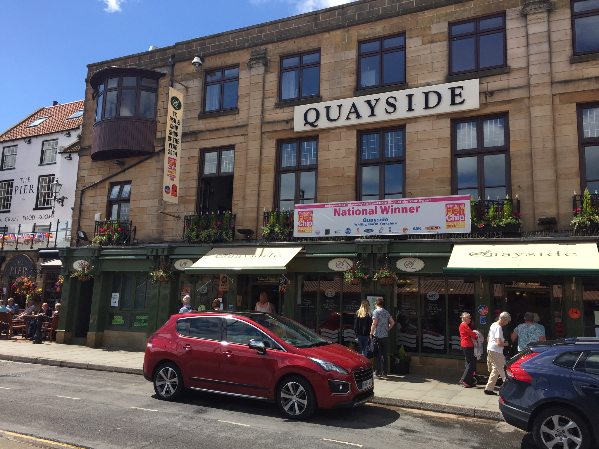 Quayside in Whitby, a very smart looking fish and chips shop!