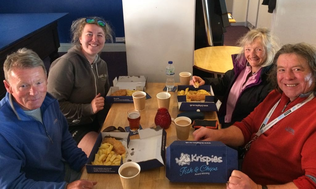 Volunteers enjoying their well deserved Fish & Chips supper.