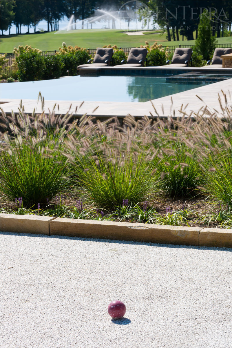 Custom Bocce Court with a crushed oyster shell playing surface & Ohio Sandstone Curbing.