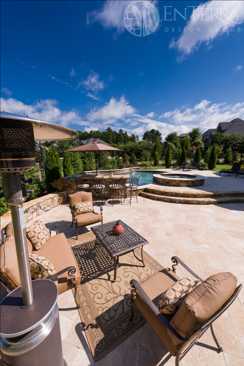 Multi-tiered French-pattern travertine pool deck.