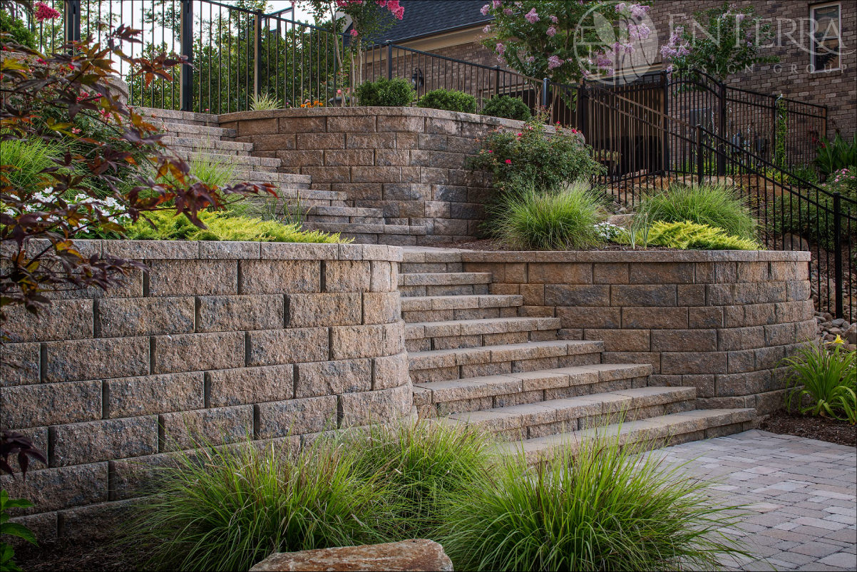 An intermediate landing and lush plantings make this functional staircase an attractive landscape feature as well.