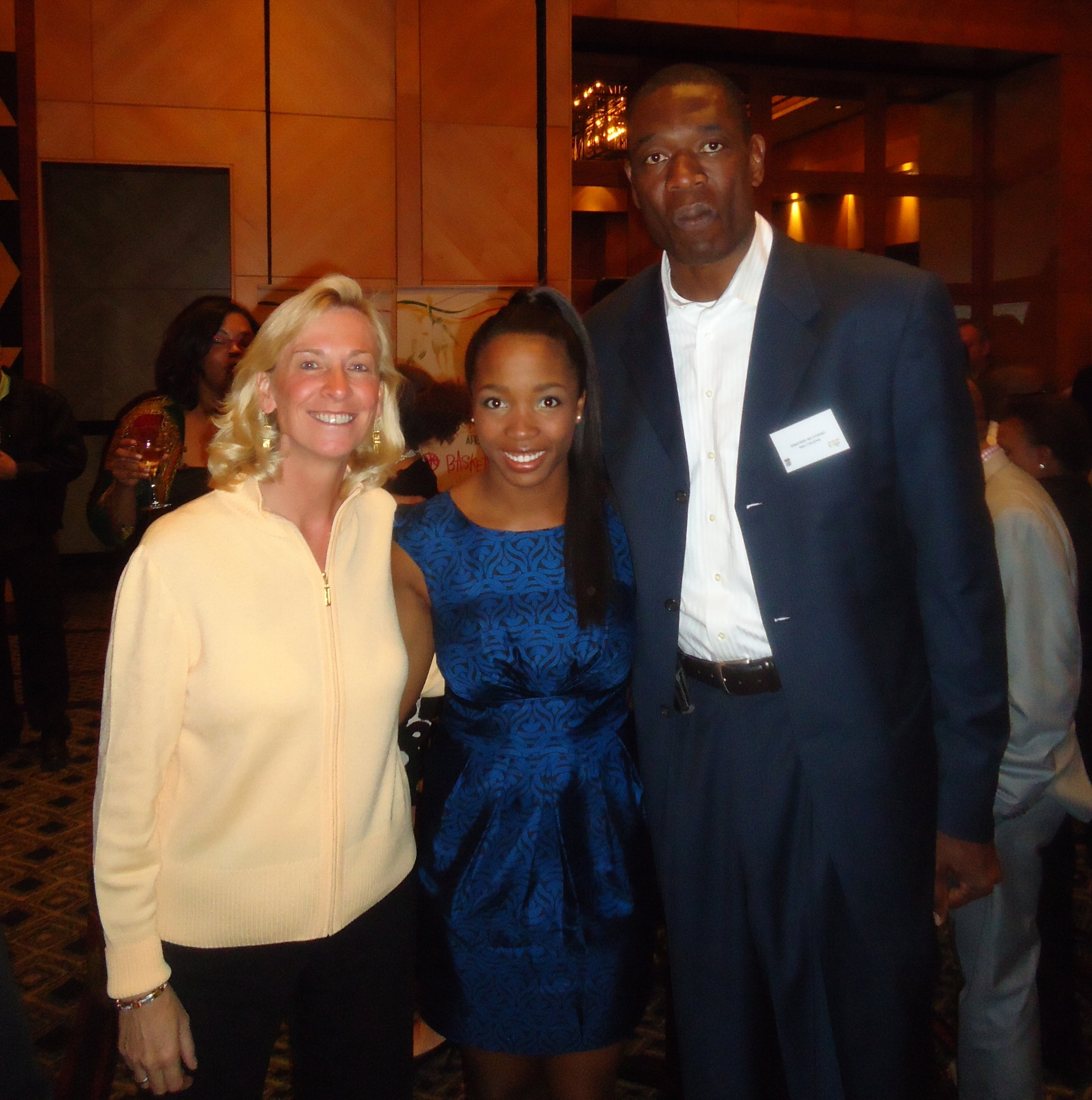 NBA LEGEND DIKEMBE MUTOMBO, GREEN, SENIOR VP NBA INTERNATIONAL, BOHUNY at basketball without borders reception in johannesburg, south africa.