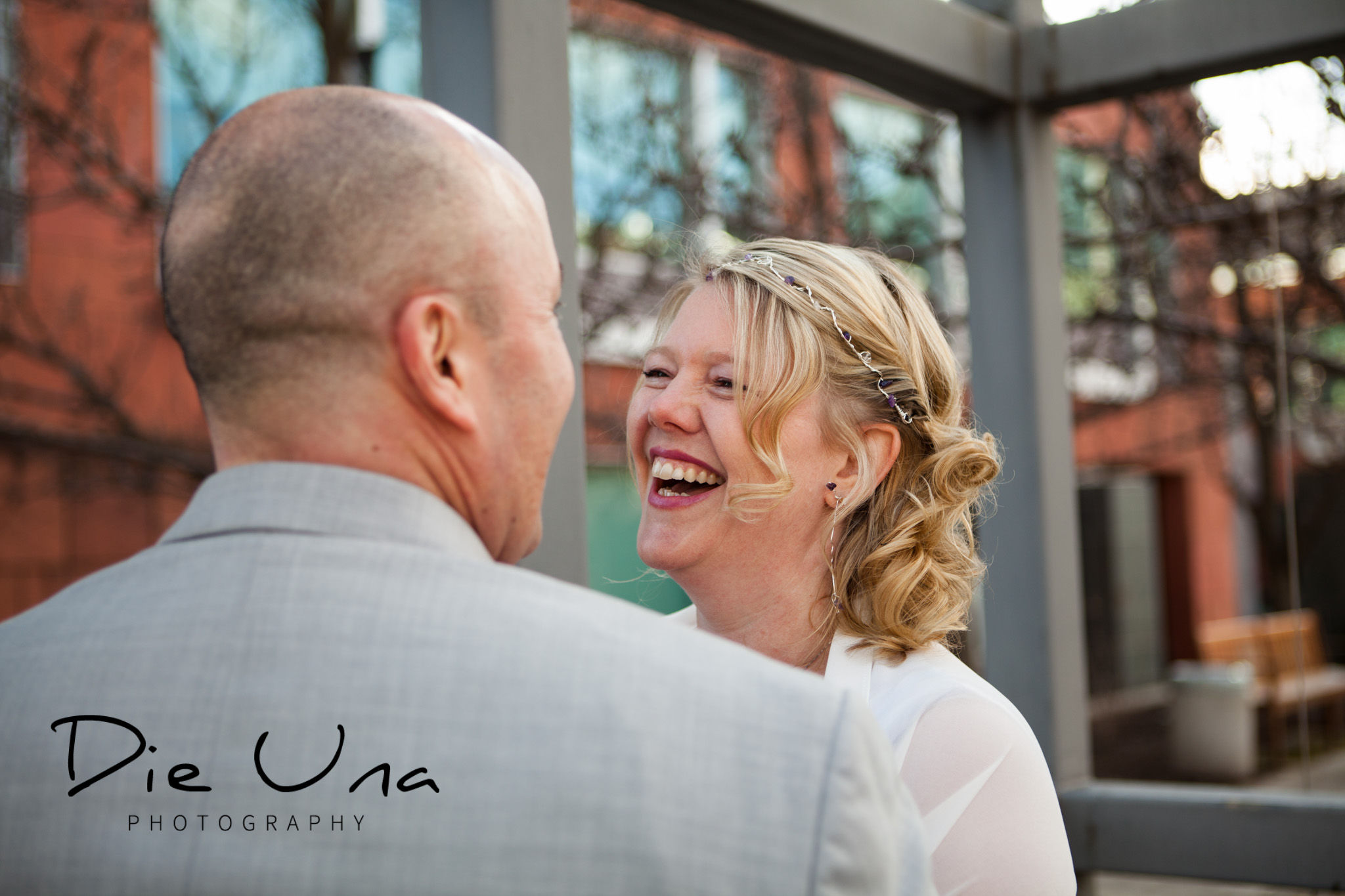 outside at Kitchener city hall with wedding couple