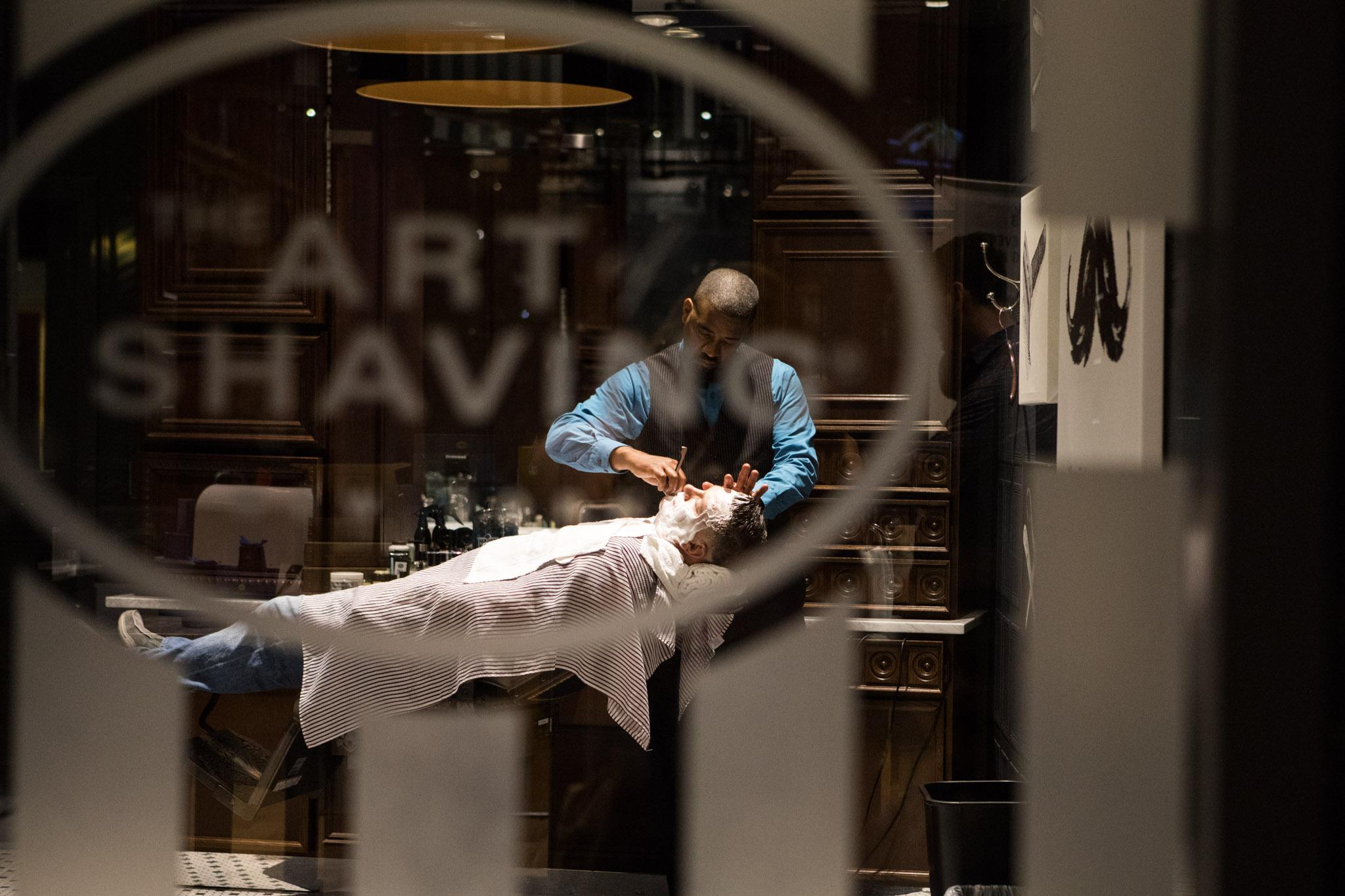 man getting a shave at Art of Shaving Las Vegas.jpg