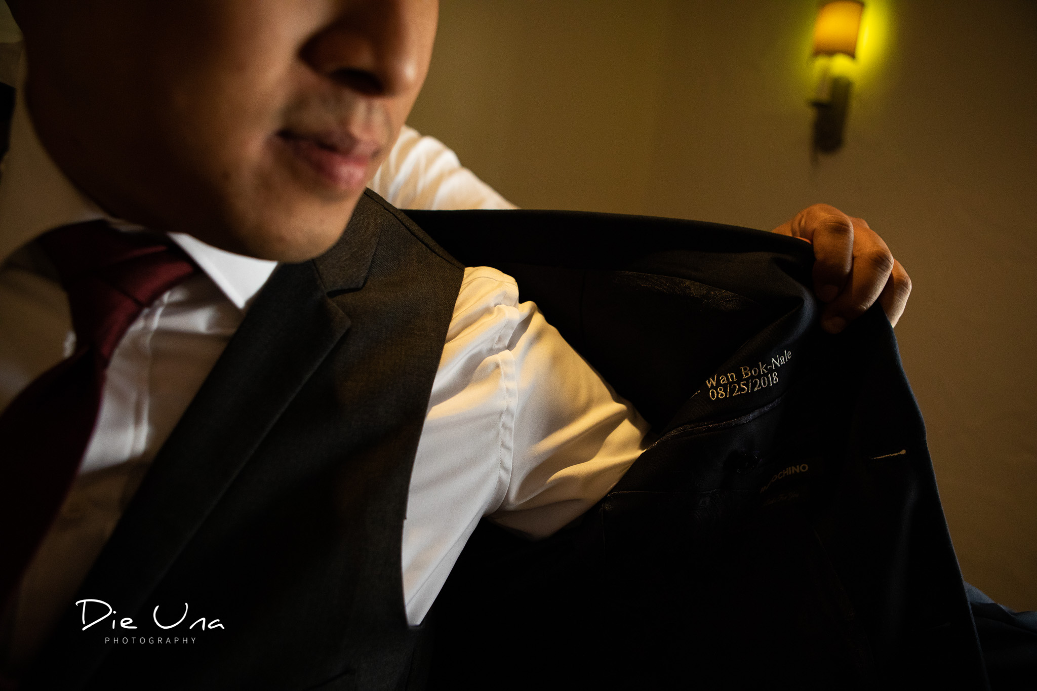 best man helping groom get on suit jacket.jpg