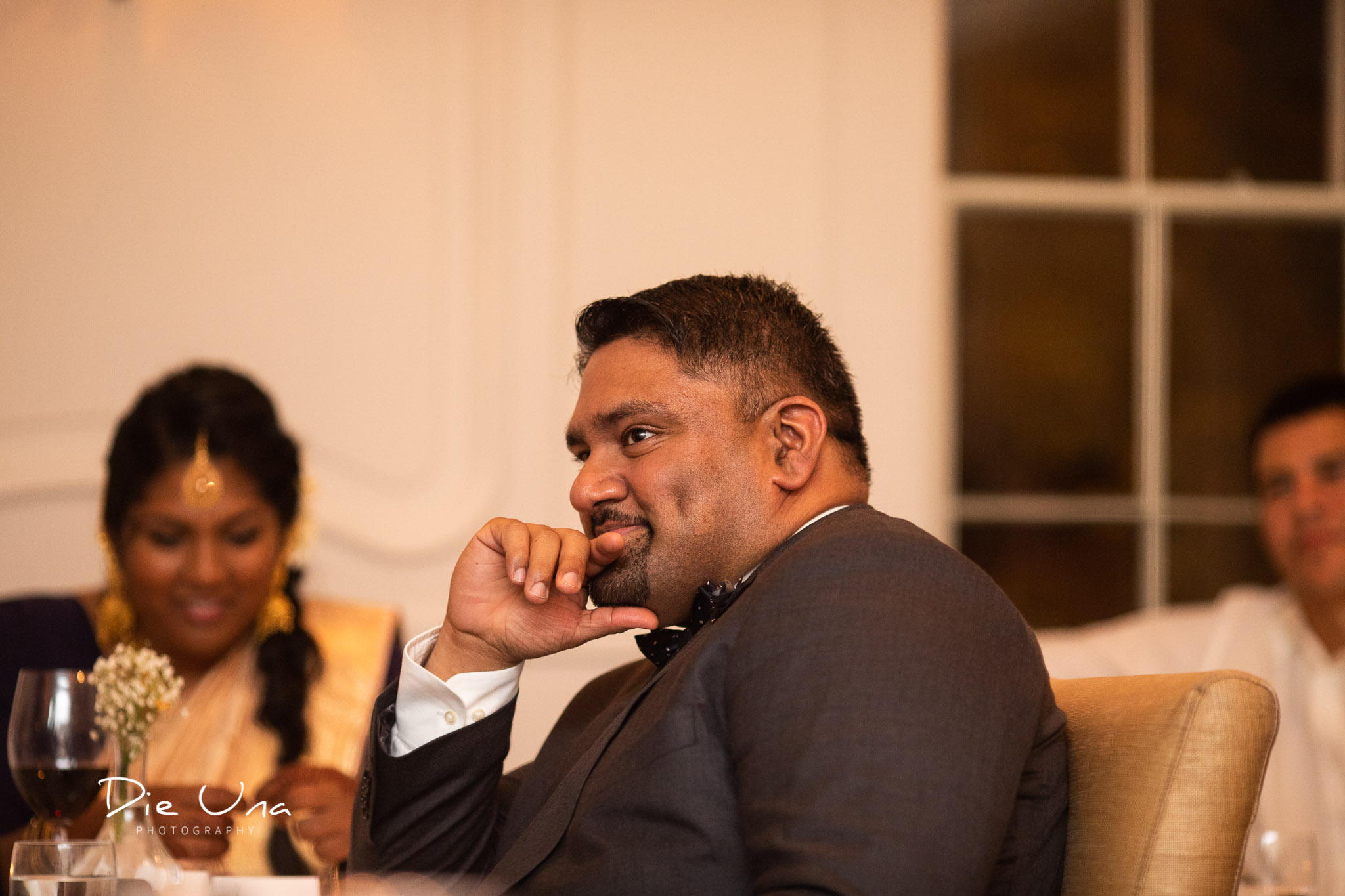 best man with a thoughtful look on his face during speeches.jpg