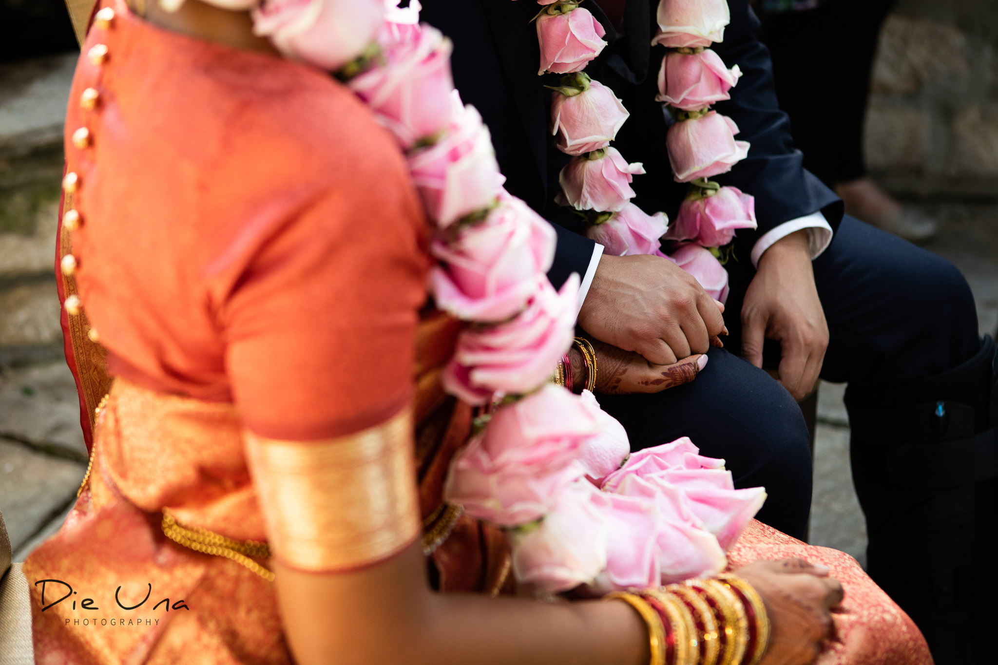 bride and groom holding hands during wedding ceremony.jpg