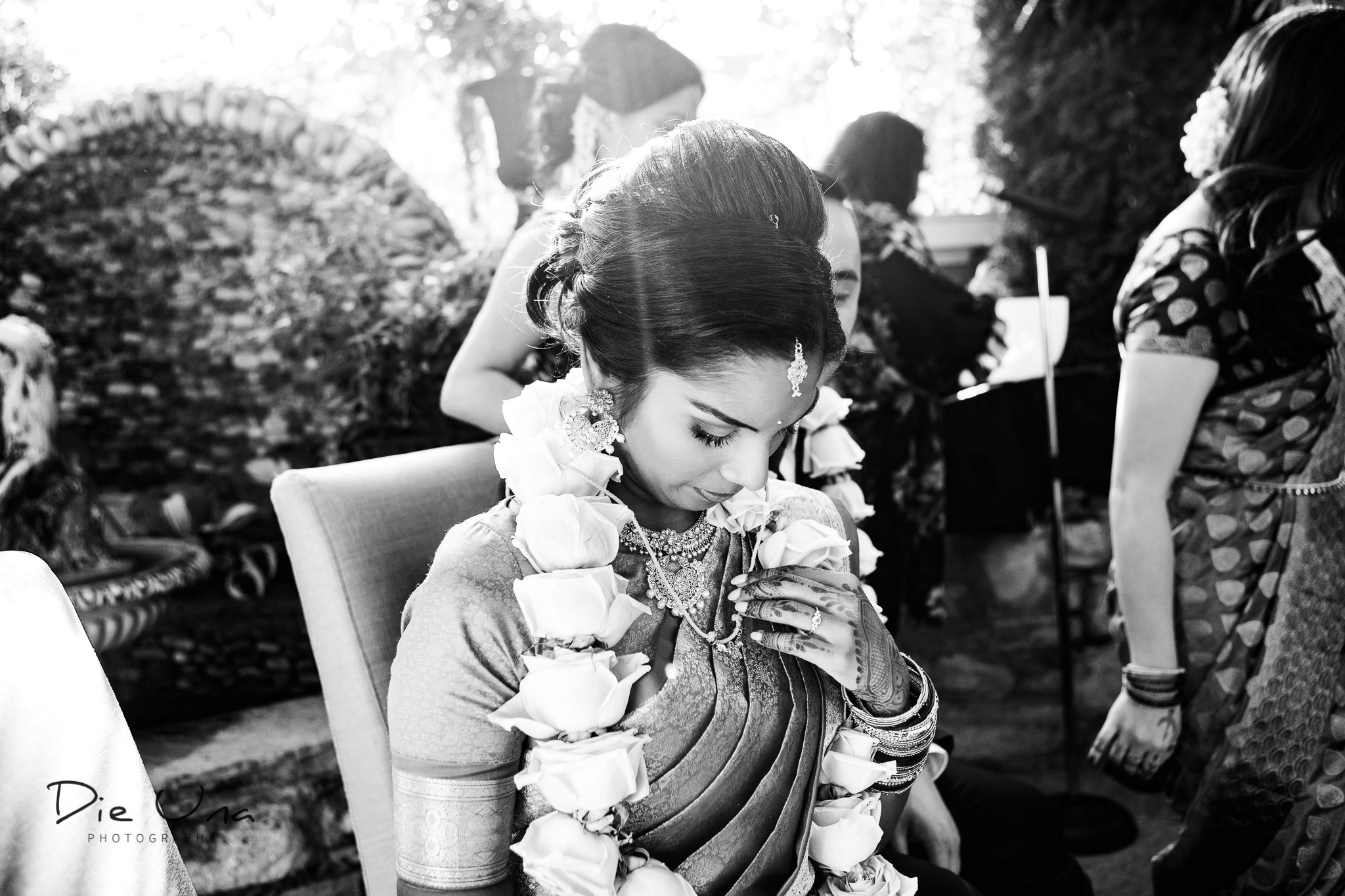 bride gazing at thaali during wedding ceremony.jpg