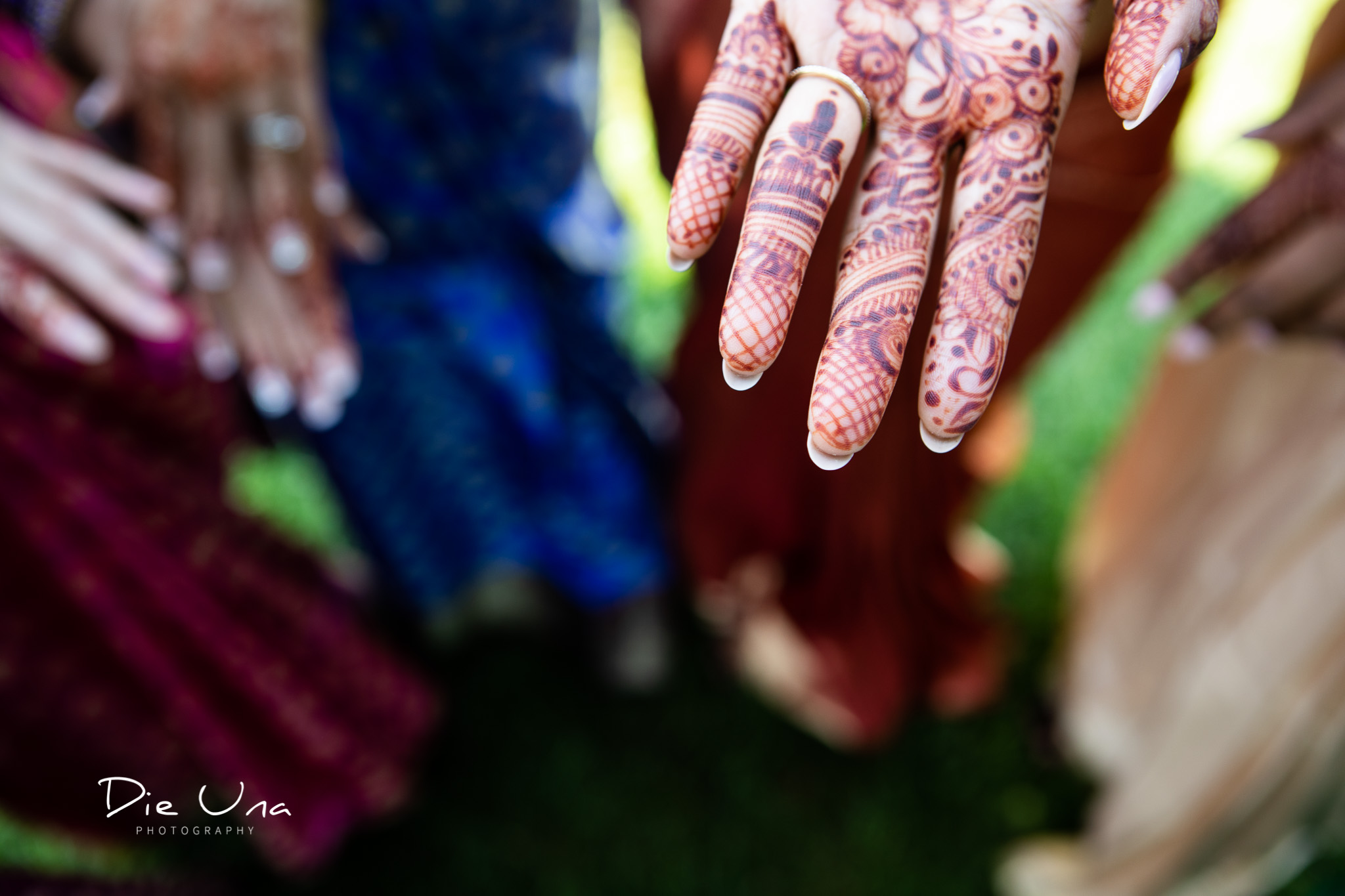 bride henna tattooed for Hindu wedding with groom's name in henna.jpg