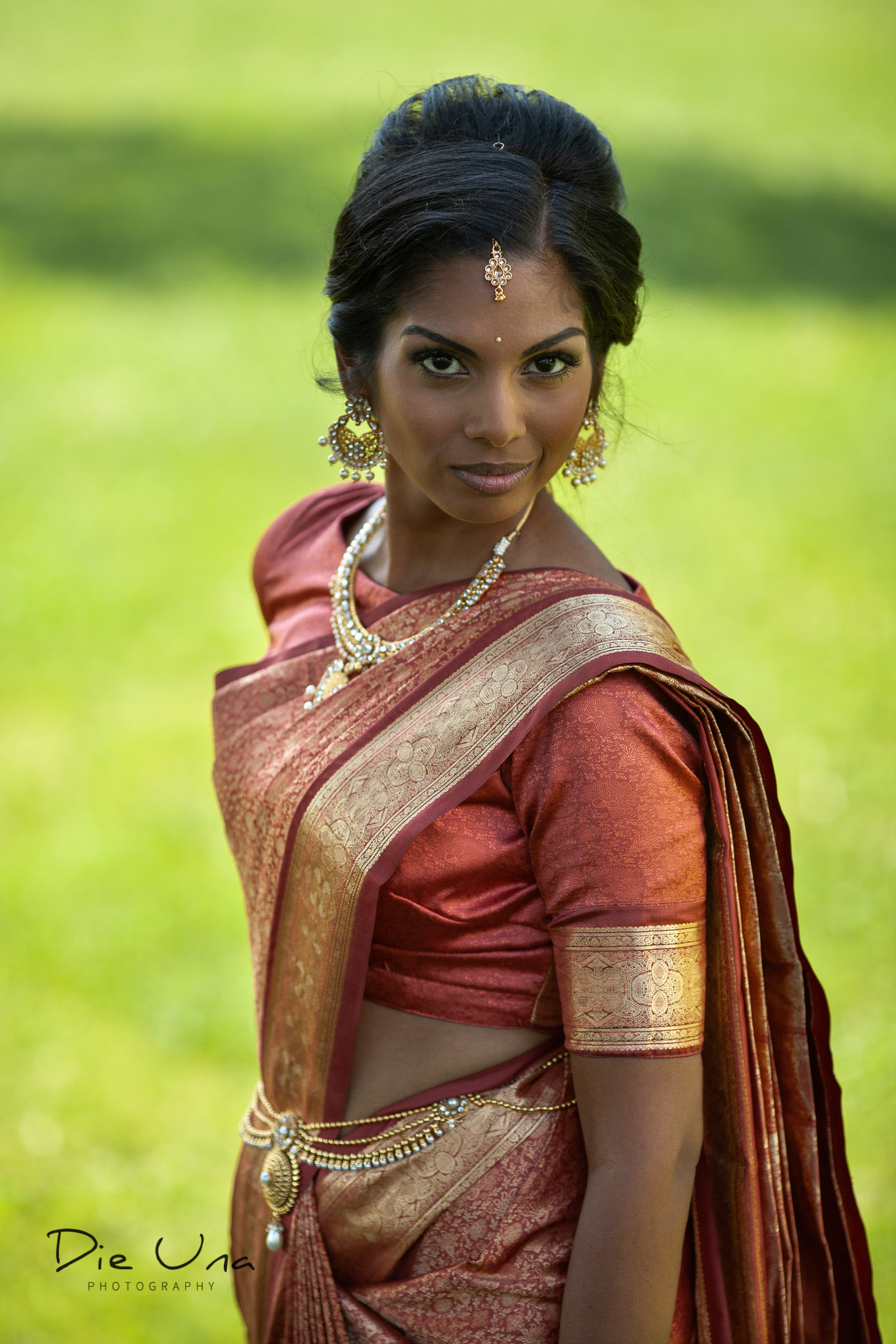 bride in saree looking at camera portrait.jpg