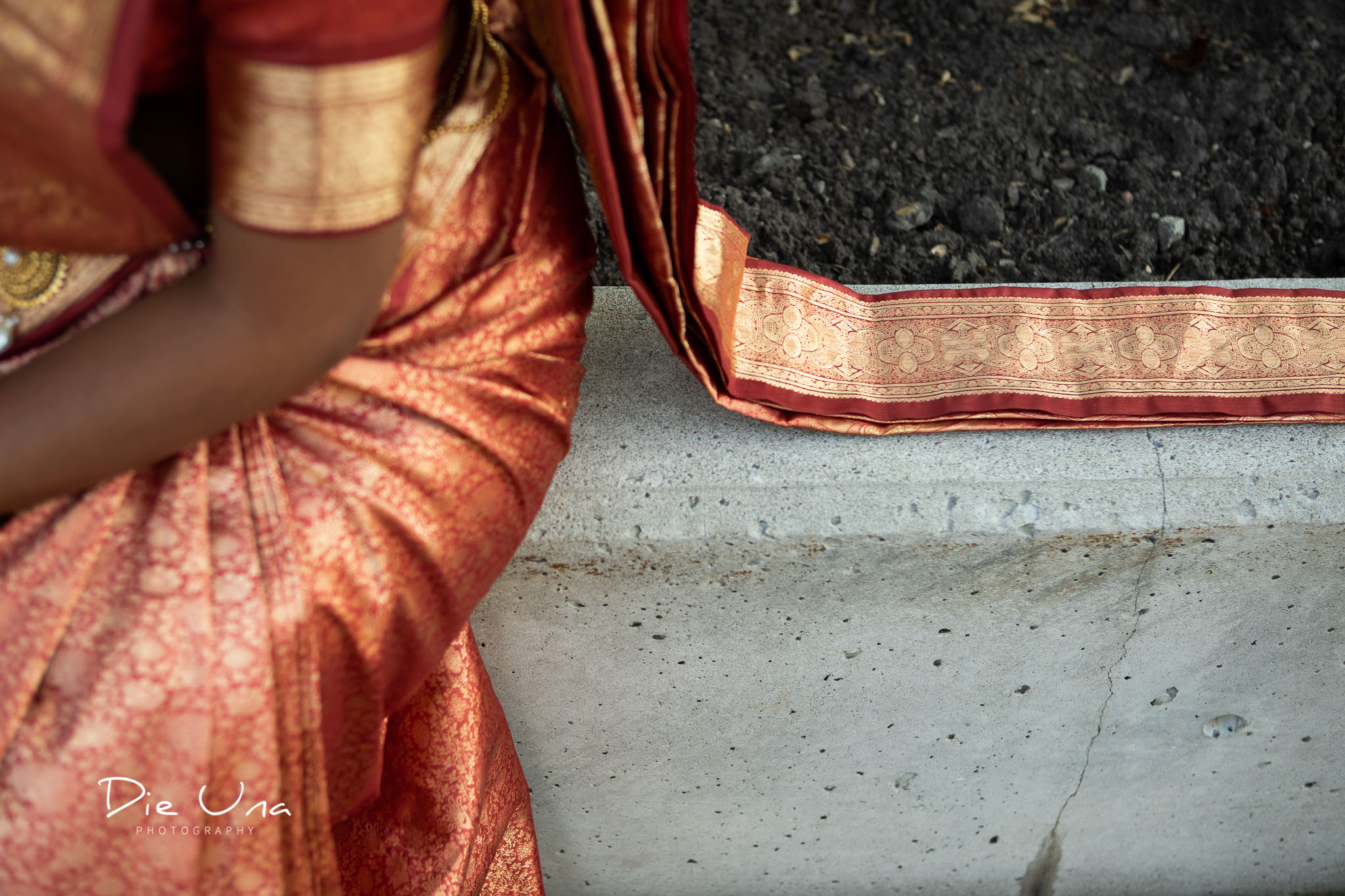 bride wearing saree detail shot.jpg