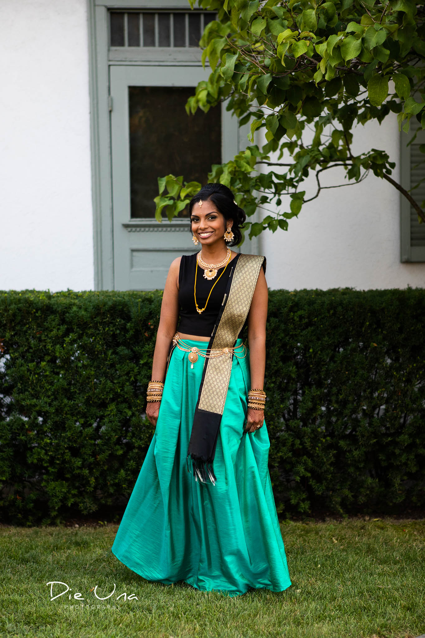 bride wearing second evening outfit with turquoise skirt and black top wearing thaali.jpg