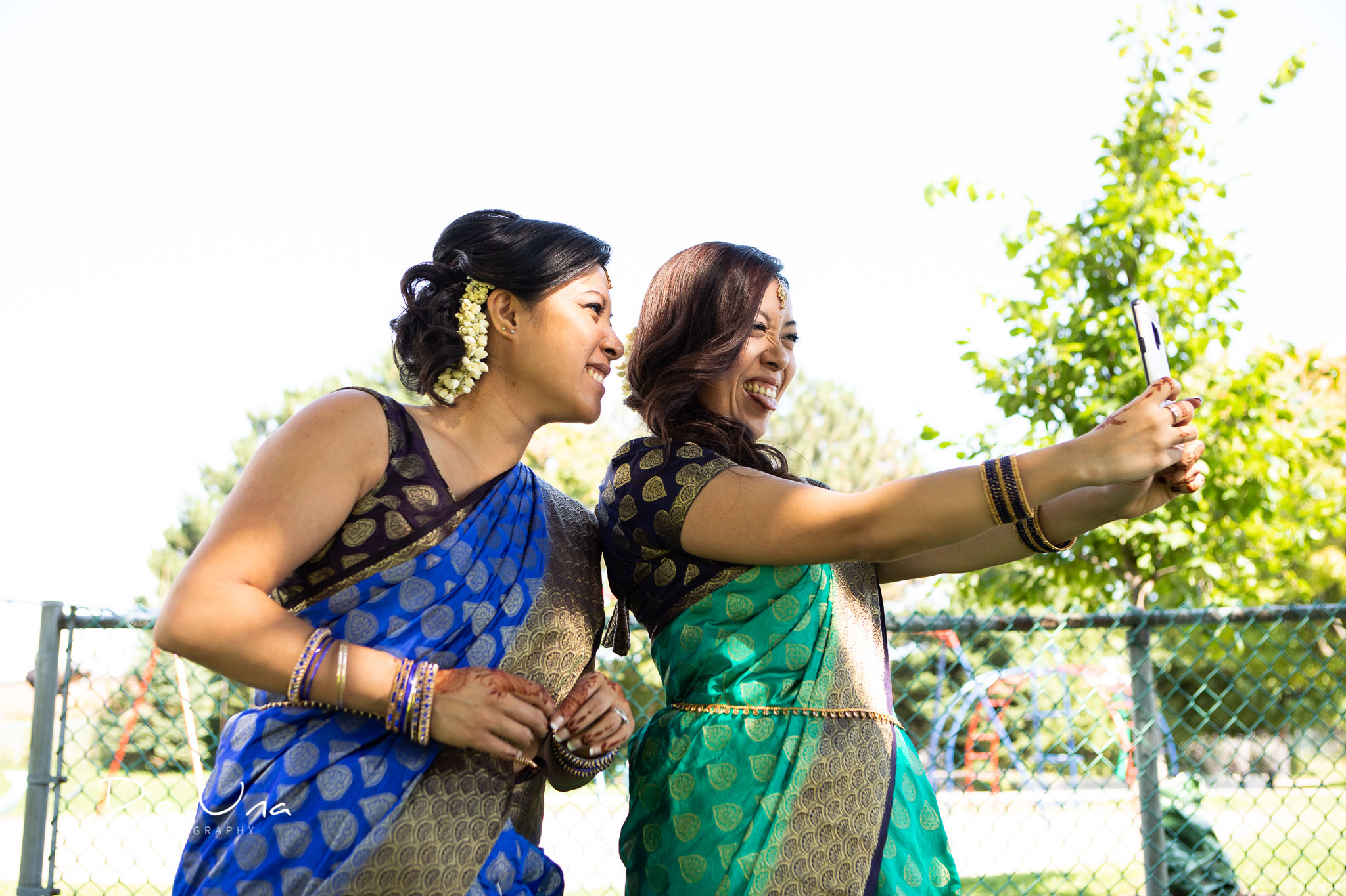 Bridesmaids taking selfies while wearing sarees.jpg