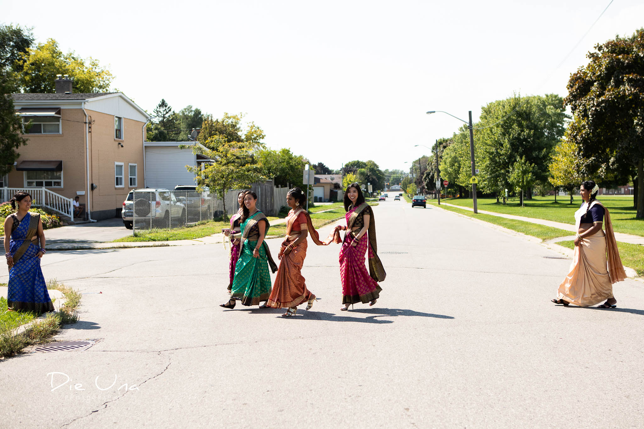bridesmaids wearing sarees in Toronto crossing the street.jpg